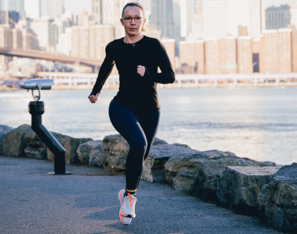 Sabrina Wieser running along the river
